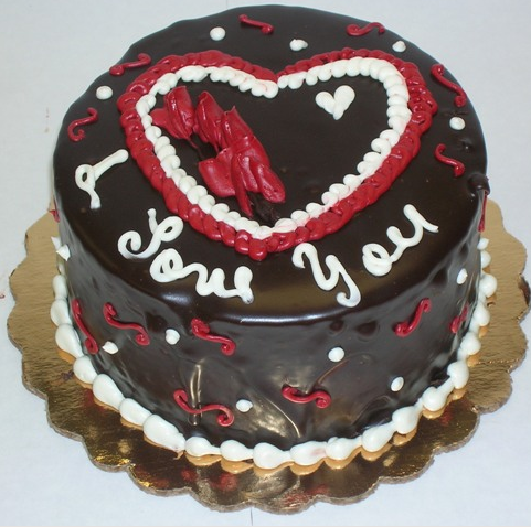 Dark chocolate valentines day cake in round shape with red and white cake decor idea.PNG