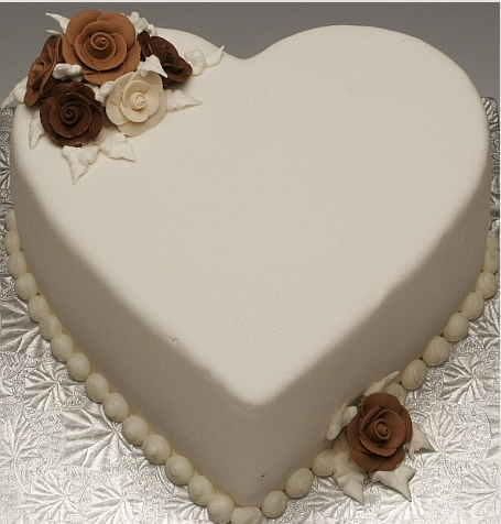 Elegant valentine cake in heart shape with chocolate flowers.PNG