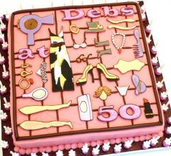 Pink accessories birthday cake for 50 year old woman.JPG
