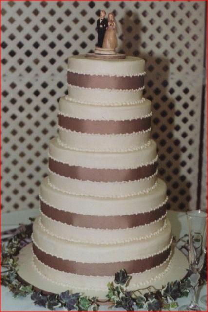 Butter cream chocolate wedding cake with ribbons.jpg