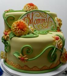 Two tier lime color cake with flowers for moms.JPG