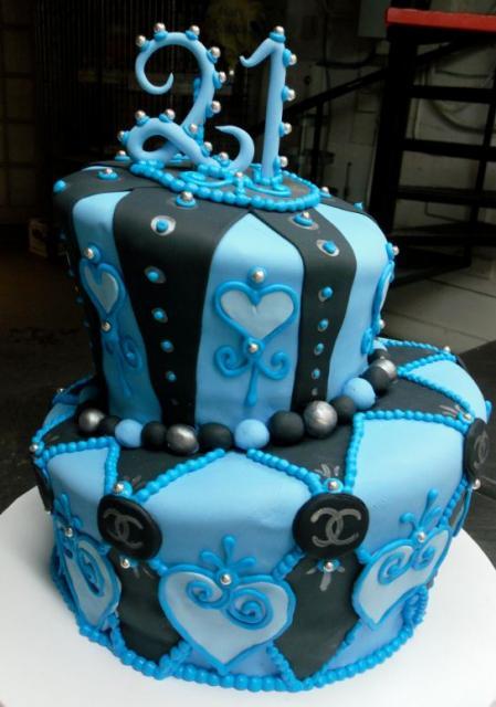 Photo of Blue + black two tier topsy turvy 21st birthday cake