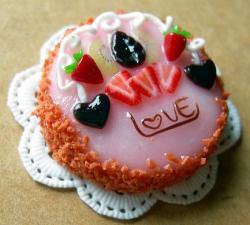Mini Valentines Cake with strawberries and heart shaped fruits and the word Love.JPG