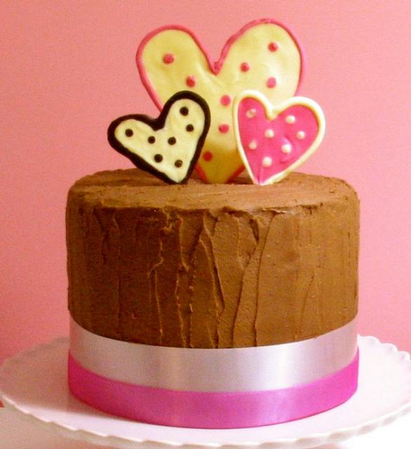 Valentine theme chocolate cake with 3 hearts on top.JPG