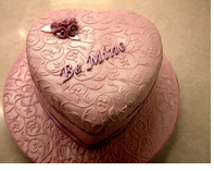 Elegnant heart shape pink valentine cake with very cool patterns cake decor.PNG
