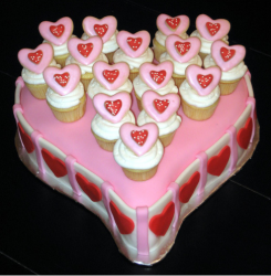 Fun valentine cake in light pink, white and red.PNG