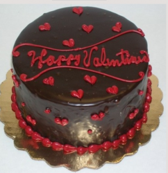 Happy valentine cake in chocolate with red hearts decor.PNG