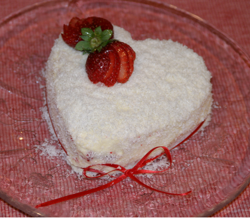 Heart shape valentine cake with coconut flakes.PNG