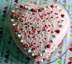 Heart shaped valentine cake with colorful cake decor.PNG