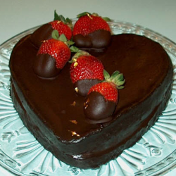 Picture of heart chocolate valentine cake with fresh strawberries toppers.PNG
