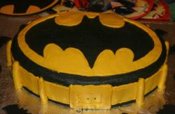 Batman symbol yellow and black cake.JPG