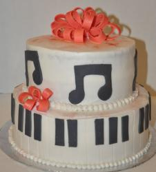 Two tier white piano and music theme cake.JPG