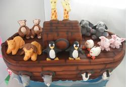 Noah's Arc theme birthday cake with 2 of each animals.JPG
