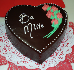 Rich heart chocoloate valentine cake with rose decor.PNG