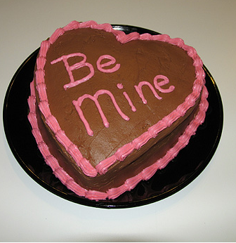 Romantic chocolate valentine cake with Be Mine words.PNG
