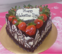 Romantic chocolate valentine cake with fresh strawberries with white chocolate cake decor.PNG