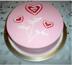 Round pink valentine cake with heart plant topper decor.PNG