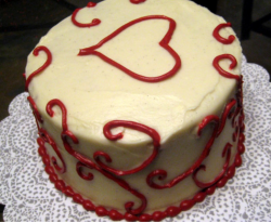 Round valentine cake with red patterns.PNG