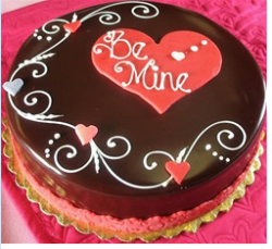 Round valentine chocolate cake with hearts decor.PNG