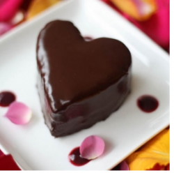 Sweet small heart shaped chocolate cake with cute decor.PNG
