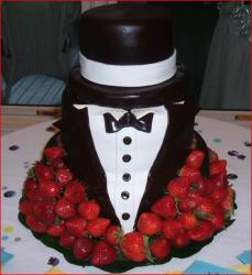 Tuxedo and tophat groomscake with fresh strawberries.jpg