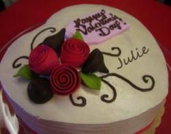 White heart-shaped Valentines day cake with red roses.JPG