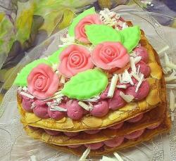 Three layer Valentines heart shape cake with pink flowers.JPG