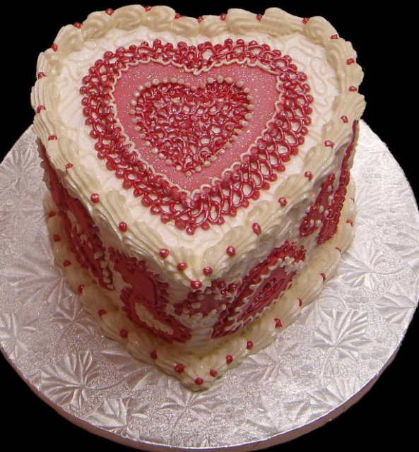Valentine cake with pretty cake decor patterns in red.PNG