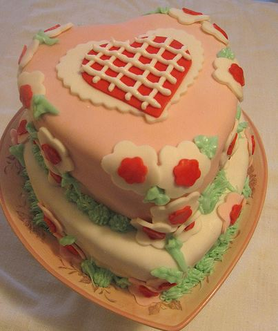 Two tier heart-shaped Valentine's cake in pink and white.JPG