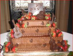 Fancy three tier square groom's cake with chocolate guitars and musical notes.jpg
