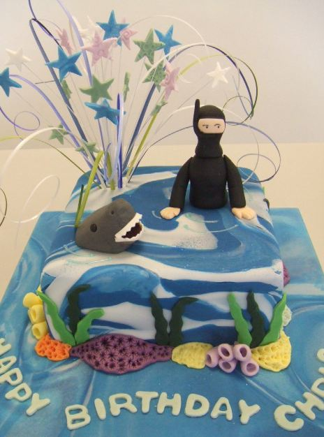 Scuba diving theme birthday cake with diver and shark.JPG