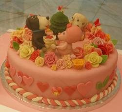 Pink Valentines cake with puppy dogs and hearts.JPG