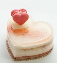 White heart shaped Valentine's cake with pink heart sandwich.JPG