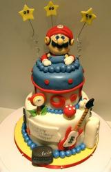 Super Mario cake with guitar and mushroom.JPG
