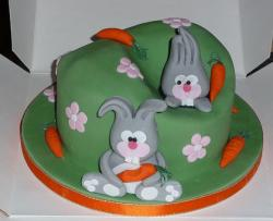 Green Easter theme cake with two bunnies and carrots.JPG