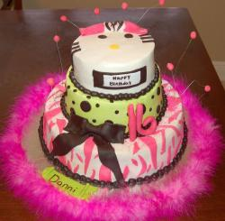 Three tier birthday cake with chocolate beads and bowtie and cat face on top for a girl.JPG