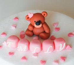 Small teddy bear Christening cake with pink blocks spelling out name.JPG