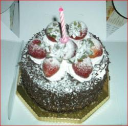 Black forest chocolate birthday cake with strawberry toppings.jpg