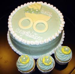 Round baby shower cake with baby carriage and matching cupcakes.JPG