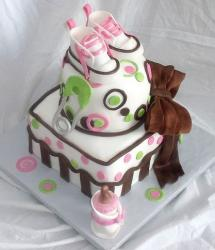 Baby shower cake with cute slippers and brown bowtie with baby bottle.JPG
