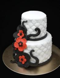 White two tier cake with black and red flowers.JPG