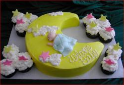 Cute Baby Shower Cake in Crescent Moon Shape and star cupcakes.jpg