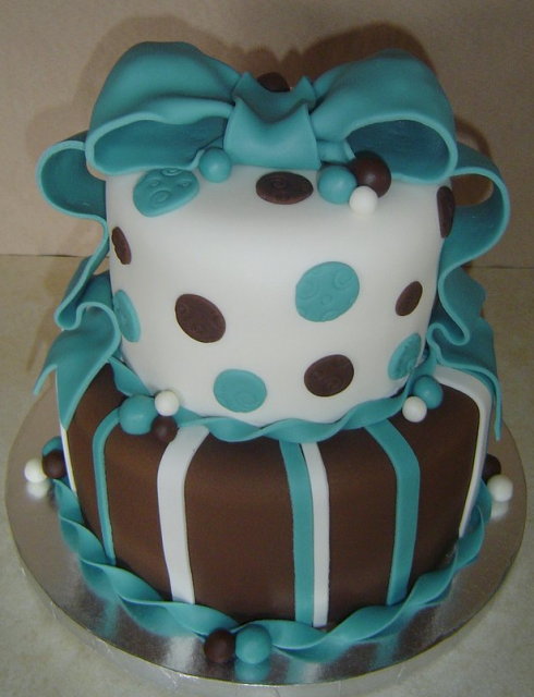 blue and white baby shower cake with booties baby shower