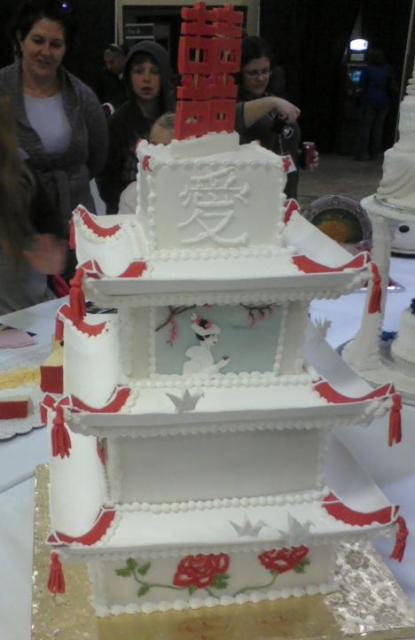 Pagoda style four tier wedding cake with Chinese character for Love and Happiness.JPG