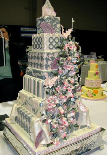 Seven Tier Chic Wedding Cake With Flowers And Fans Jpg 1