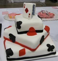 Three tier white poker card theme cake with Ace card on top.JPG