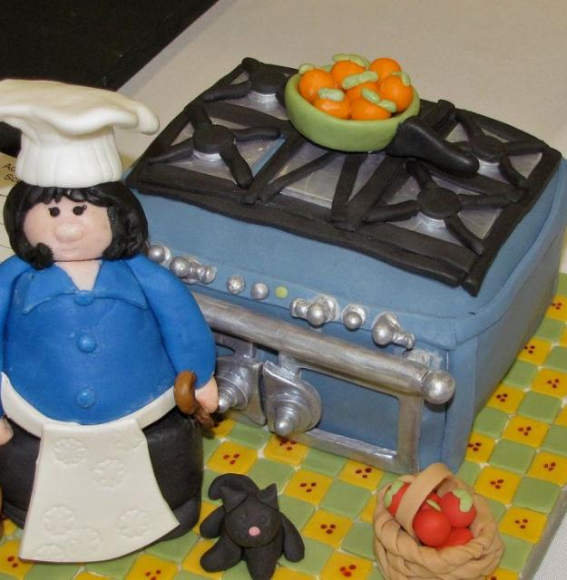 Woman Chef In The Kitchen With Stove Cake.JPG Hi-Res 720p HD
