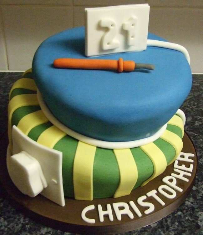 Two tier birthday cake with electrician theme.JPG