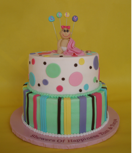 Colorful Baby Shower Cake with cute baby topper smiling.PNG
