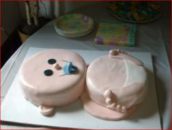 Baby shower cake in the shape of a newborn baby.jpg